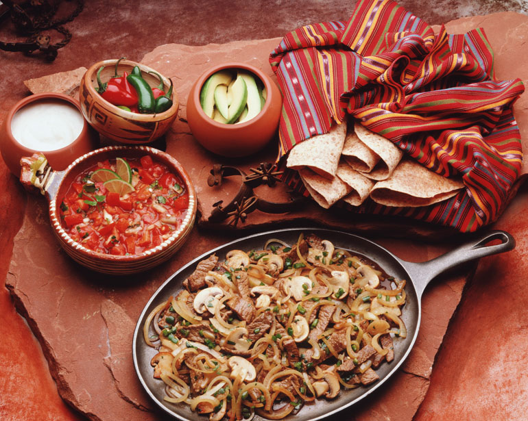 Mexican cuisine, meat, mushrooms and onions